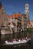 Bruges canals. Touristic boat ride on the canals of the historic town of Bruges, Belgium Royalty Free Stock Photos