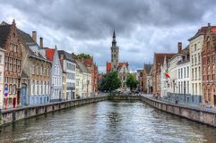 Bruges canals and Van Eyck square, Belgium stock images