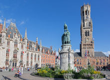 Bruges - The Carriage on the Grote Markt and Belfort van Brugge in background. Stock Photos