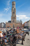 Bruges - The Carriage on the Grote Markt and Belfort van Brugge in background. Stock Image