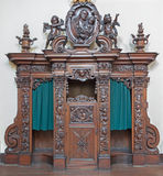 Bruges - The carved confession box in Karmelietenkerk (Carmelites church) Royalty Free Stock Photo