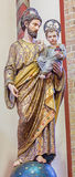Bruges - Carved polychrome satatue of Holy Jospeph in st. Giles church (Sint Gilliskerk) Stock Images