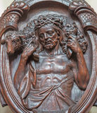 Bruges - The carved relief of Good shepherd on the confession box in Karmelietenkerk Royalty Free Stock Photo