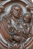 Bruges - The carved relief of st. Joseph in Karmelietenkerk (Carmelites church) Royalty Free Stock Photo