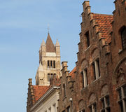 Bruges, Cathedral and gables. Cathedral of Saint Saviour and step-roofed houses against blue sky in Bruges, Flanders, Belgium, Europe Stock Photo