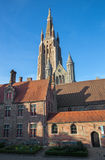 Bruges - Church of Our Lady from yard of Saint John Hospital (Sint Janshospitaal) in evening Royalty Free Stock Photo