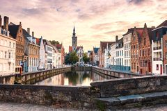 Bruges cityscape. Old Brugge town famous destination in Europe. Brugge in evening with colorful sky. Ancient buildings at the water canal. Bruges skyline stock photography