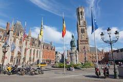 Bruges - Grote markt with the Belfort van Brugge and Provinciaal Hof buildings and memorial of Jan Breydel and Pieter De Coninck Royalty Free Stock Images