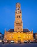 Bruges - Grote markt in evening dusk and Belfort van Brugge. Stock Photos