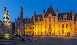 Bruges - Grote Markt and the Provinciaal Hof gothic building and Historium building in evening Stock Photography