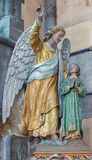 Bruges - The Guardian angel statu in the church Our Lady. Stock Photo