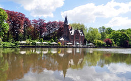 Bruges historic building reflection on lake. The reflection of the historic building & x28;Kasteel Restaurant& x29; on the Lake of Love, Minnewater park, Bruges Stock Photos