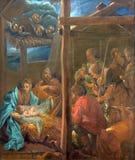 Bruges - Kristi födelsemålarfärgen vid Januari skåpbil håla Kerckhove 1707 i kyrkan för st Jacobs (Jakobskerk) arkivfoton