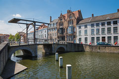 Bruges - Little bascule bridge and typically house over the canal from Sint Annarei street. Royalty Free Stock Image
