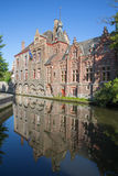 Bruges - Look from Dijver street to canal with the mirror of typically houses. Royalty Free Stock Photo