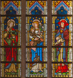 Bruges - Madonna with the saints on the windowpane in st. Giles church (Sint Gilliskerk) Royalty Free Stock Image