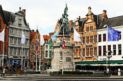 Bruges. Market suare, Belgium. Tourists walking and resting in restaurants abd cafes round the statue of Jan Breydel and Pieter de Coninck. Photo was taken in Stock Images