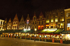 Bruges by night. Bruges, Belgium - April 11, 2012: View of Bruges market by night, showing restaurants and gardens Stock Photos