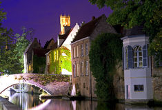 Bruges at night. Bruges bridge at night, canal and belfry view Royalty Free Stock Photo