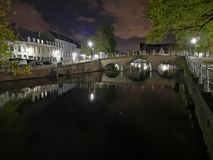 Bruges at night. Medieval city, reflexion on water. Bruges at night canal view. Medieval city, reflexion on the canals water stock image