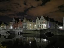 Bruges at night. Medieval city, reflexion on water. Bruges at night canal view. Medieval city, reflexion on the canals water royalty free stock photography