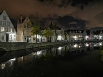 Bruges at night. Medieval city, reflexion on water. Bruges at night canal view. Medieval city, reflexion on the canals water stock photo