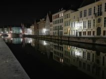 Bruges at night. Medieval city, reflexion on water. Bruges at night canal view. Medieval city, reflexion on the canals water royalty free stock images