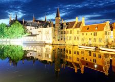 Bruges - Night  historic medieval buildings along a canal, Belgi Stock Photography