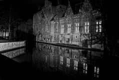 Bruges by night. View of traditional buildings and canal in Bruges, Belgium Royalty Free Stock Photos