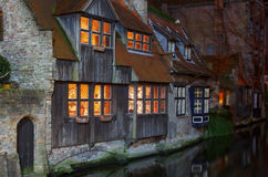 Bruges. Old house on the canal at night Stock Images