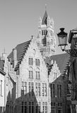 Bruges - St. Salvator's Cathedral (Salvatorskerk) in the background and the typically brick houses. Royalty Free Stock Image
