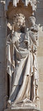 Bruges - Statue of Madonna on facade of town hall. Stock Image