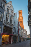 Bruges - The tower of Belfort van Brugge in the morning light from Breidelstraat Stock Photos