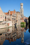Bruges - View from the Rozenhoedkaai in Brugge with the Perez de Malvenda house and Belfort van Brugge in the background in mornin Stock Images