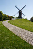 Bruges Windmill with path. Windmill and path with a clear blue sky in Bruges, Belgium, Europe Stock Photography