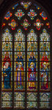 Bruges - The Windowpane with the saints in the in st. Giles church (Sint Gilliskerk). Stock Photos