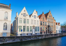 Bruges (Brugge), Belgium, February 2016, Spinolarei, Typical belgian street with traditional  houses and water canal Royalty Free Stock Images