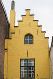 Bruges, yellow gable end of old town house. Royalty Free Stock Images