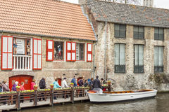 BRUGGE, BELGIUM - APRIL 22: Boat tour into the can Royalty Free Stock Photography