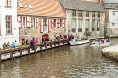 BRUGGE, BELGIUM - APRIL 22: Boat tour into the can Royalty Free Stock Images