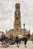 BRUGGE, BELGIUM - APRIL 22:Horses and carriages in Stock Photo