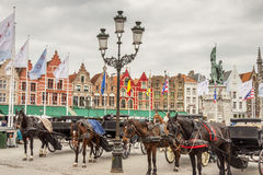 BRUGGE, BELGIUM - APRIL 22:Horses and carriages in Royalty Free Stock Images