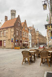 BRUGGE, BELGIUM - APRIL 22:Sidewalk on the old str Stock Photography