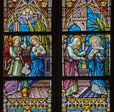 BRUGGE, BELGIUM - JUNE 12, 2014: The Annunciation and the Vistation to Elizabeth scene on the windwopane in st. Jacobs church Royalty Free Stock Image