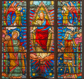 BRUGGE, BELGIUM - JUNE 13, 2014: Jesus Christ from windowpane (19. cent.) in st. Giles Stock Photo