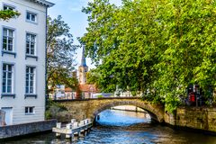 One of the many canals with the stone arch bridges in historic Bruges, Belgium. Brugge/Belgium - Sept. 18 2018: One of the many canals with the stone arch stock photos