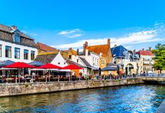 Typical canal scene and surrounding restaurants in the historic city of Bruges, Belgium. Brugge/Belgium - Sept. 18 2018: Typical canal scene and surrounding stock images