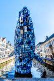 A whale made of 5 tons of plastic waster rises up out of a canal in Bruges, Belgium royalty free stock photography