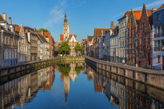 Brugge - Canal and Spigelrei and Spinolarei street with the Burghers lodge building in morning Royalty Free Stock Image