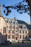 Brugge - Gruuthusemuseum in evening. Light and the heraldry Royalty Free Stock Photos